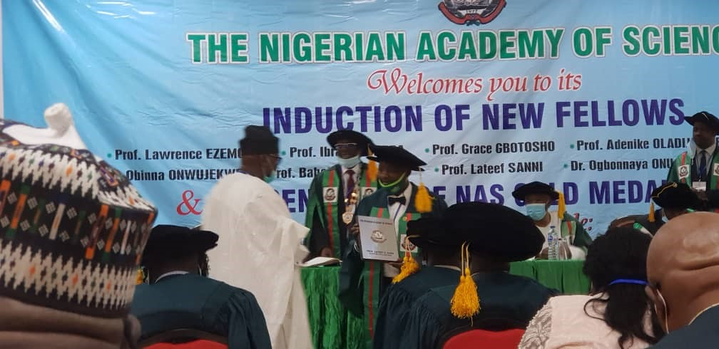 Prof. Lateef Sanni receiving his award of fellowship of the Nigerian Academy of Science